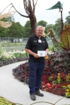 Chris Evans in Bournemouth City Council's show garden, Collection Holder of Abelia and Clethra