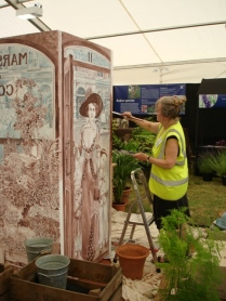 Cherryl Fountain puts the finishing touches to her backdrop for Jim Marshalls stand