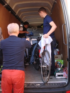 Bikes being carefully packed into the van