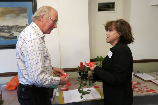 Plant Exchange Coordinator Lloyd Kenyon discussing red labels