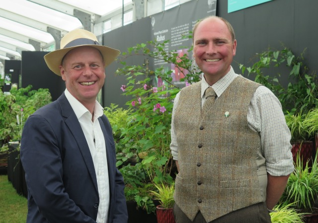 BBC presenter Joe Swift with Philip Oostenbrink filming his National Plant Collection of Hakonechloa macra & cultivars